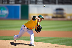 OAKLAND, CA - SEPTEMBER 22: Sonny Gray #54 of the Oakland Athletics pitches against the Minnesota Twins during the first inning at O.co Coliseum on September 22, 2013 in Oakland, California. The Oakland Athletics defeated the Minnesota Twins 11-7 as they clinched the American League West Division. (Photo by Jason O. Watson/Getty Images) *** Local Caption *** Sonny Gray