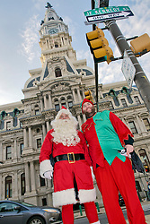 At his arrival in the region, Scuba Santa tours Philadelphia and visits local touristic attractions. The trip brings Scuba Santa and his helper, Elffish from 30th Street station via City Hall and Independence Mall to Penn's Landing where he and his helper board for Camden. The fire boat of the Camden Fire Dept. brings them to the other side of the Delaware River where a Ladder and Engine are waiting for the final stretch of the trip towards the Ocean Realm theater of the Adventure Aquarium.