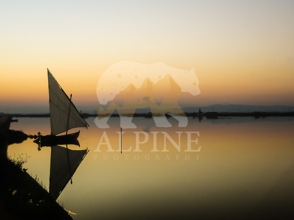 A sailing boat as seen in the twilight at Albufera lagoon, Valencia, Spain.