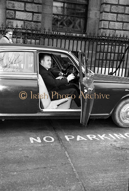 Neill Blaney, Minister for Local Government, takes the wheel to complete the new driving test. It was probably not a good idea to begin in a NO PARKING zone .<br /> 23.03.1964