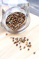 Mustard seeds in jar - studio shot