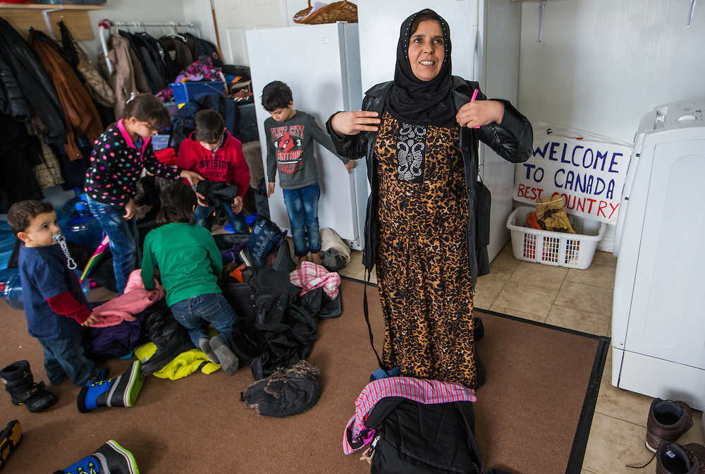 Syrian Refugee Sawsan Al Jasem, looks on as her children get ready to go outside inside their temporary home in Picton, Ontario, Canada, Wednesday January 20, 2016.   (Mark Blinch for the BBC)