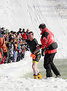 Warwick, NY - A skier is helped out of the water after falling at the end of a run during the Spring Rally at Mount Peter in Warwick on March 29, 2008.