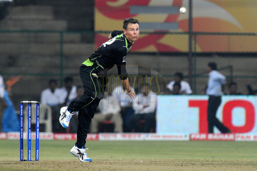 Johan Botha of Warriors bowls during match 1 of the NOKIA Champions League T20 ( CLT20 )between the Royal Challengers Bangalore and the Warriors held at the  M.Chinnaswamy Stadium in Bangalore , Karnataka, India on the 23rd September 2011..Photo by Pal Pillai/BCCI/SPORTZPICS
