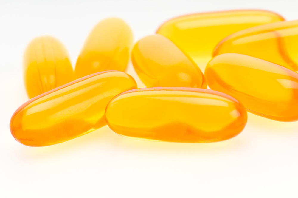 Close up view of Omega 3 pills. Macro shot with use of selective focus.