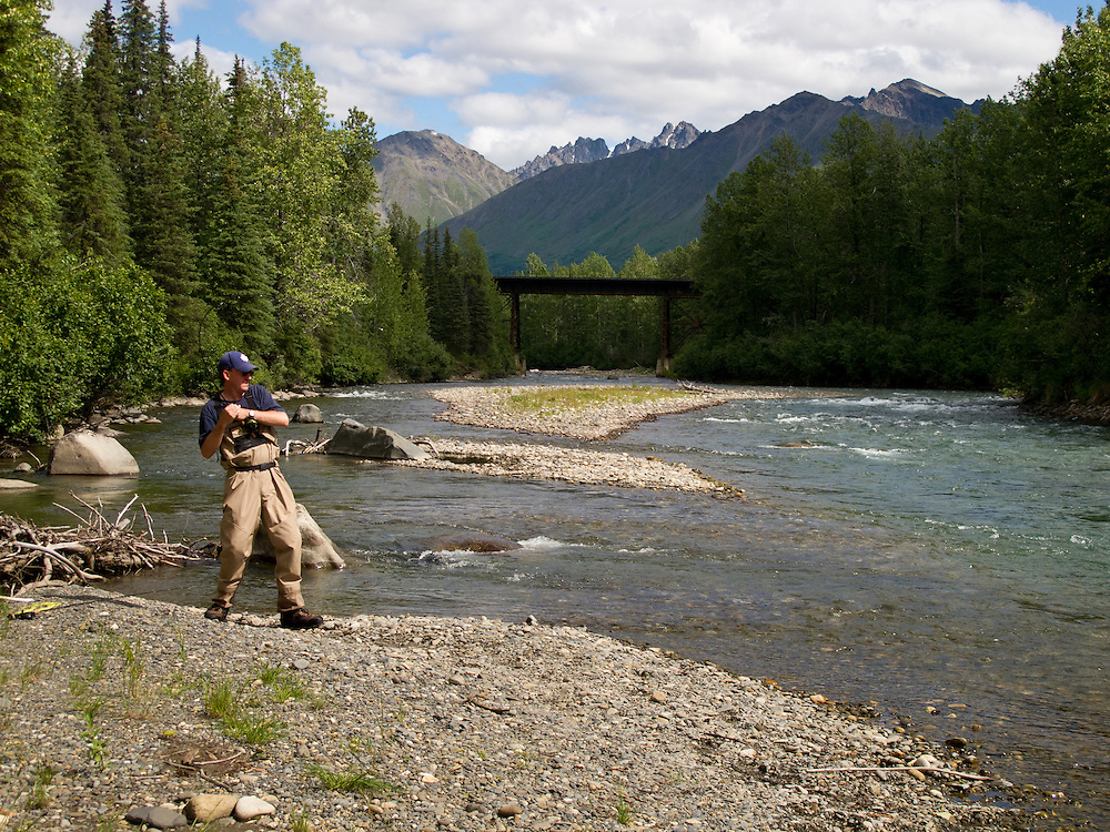 George Rogers fighting a fly caught king salmon in the East Fork of the Chulitna River, Alaska