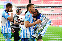 Free to use courtesy of Sky Bet. Maxime Biamou of Coventry City with the Sky Bet league Two play off final trophy - Mandatory by-line: Dougie Allward/JMP - 28/05/2018 - FOOTBALL - Wembley Stadium - London, England - Coventry City v Exeter City - Sky Bet League Two Play-off Final