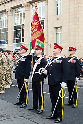 Barnsley turned out in force to welcome home from Operation Herrick 16 The Light Dragoons Englands Northern Cavalry  today (13th November 2012). Led by the Band of Heavy Cavalry and Cambrai around 250 troops supported by military vehicles made their way around Barnsley Town centre to the town hall for an official reception, a presentation and inspection... Left to right from Barnsley SQMS Steve Crossland, RQMS(T) Mike Wilkinson and SQMS Jamie Bower make up part of the Guidon Party (regimental standard Party) in their home town. along with WO1 David Rae from Hull..13 November 2012.Image © Paul David Drabble