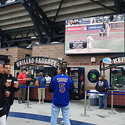 Fans shop for fast food and drink's inside the stadium during the New York Mets V Arizona Diamondbacks Baseball game at Citi Field, Queens, New York. 5th May 2012. Photo Tim Clayton