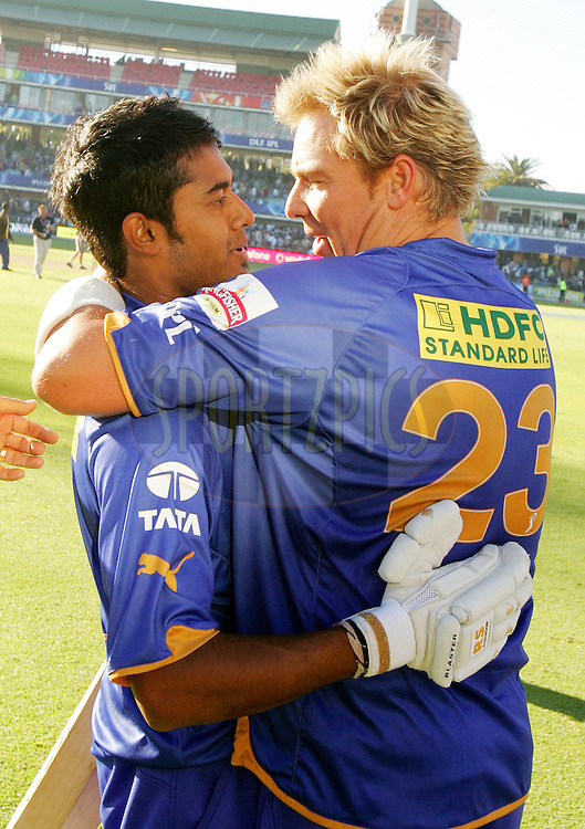 PORT ELIZABETH, SOUTH AFRICA - 02 May 2009. Shane Warne congratulates Abhishek Raut during the  IPL Season 2 match between the Deccan Chargers and the Rajatshan Royals held at St Georges Park in Port Elizabeth , South Africa..