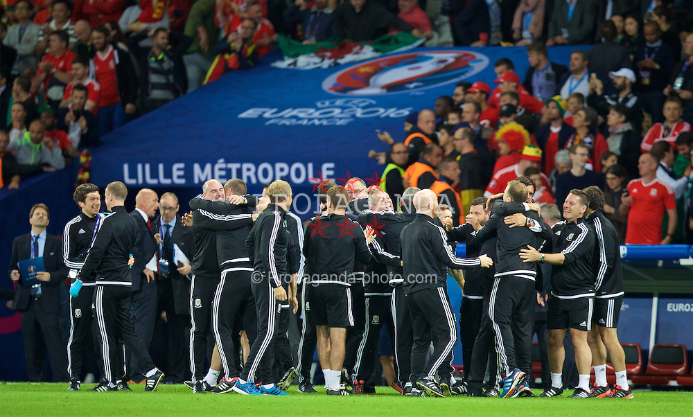 LILLE, FRANCE - Friday, July 1, 2016: Wales staff celebrate with masseur Chris Senior after a 3-1 victory over Belgium and reaching the Semi-Final during the UEFA Euro 2016 Championship Quarter-Final match at the Stade Pierre Mauroy. (Pic by David Rawcliffe/Propaganda)