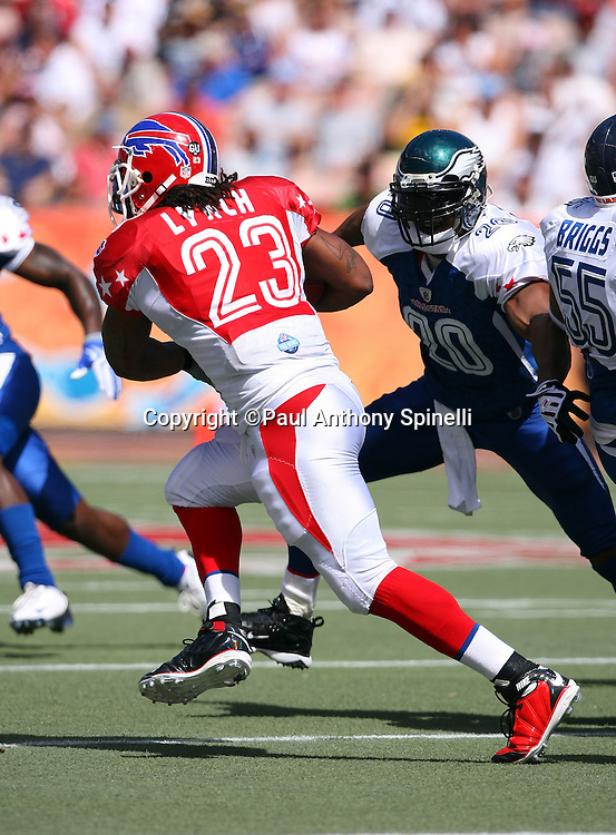 HONOLULU, HI - FEBRUARY 08: AFC All-Stars running back Marshawn Lynch #23 of the Buffalo Bills runs the ball while trying to avoid a tackle by free safety Brian Dawkins #20 of the Philadelphia Eagles of the NFC All-Stars in the 2009 NFL Pro Bowl at Aloha Stadium on February 8, 2009 in Honolulu, Hawaii. The NFC defeated the AFC 30-21. ©Paul Anthony Spinelli *** Local Caption *** Marshawn Lynch;Brian Dawkins