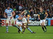 South Africa's Damian De Allende with a one handed offload during the Rugby World Cup Bronze Final match between South Africa and Argentina at the Queen Elizabeth II Olympic Park, London, United Kingdom on 30 October 2015. Photo by Matthew Redman.