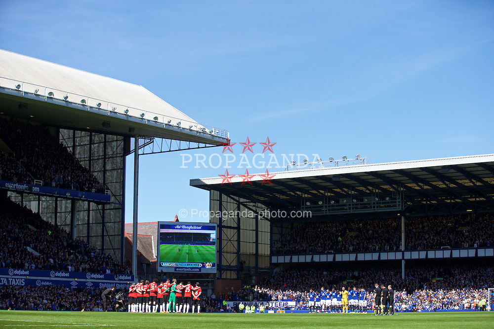LIVERPOOL, ENGLAND - Sunday, April 26, 2015: Everton and Manchester United players stand to remember former chairman Sir Philip Carter before the Premier League match at Goodison Park. (Pic by David Rawcliffe/Propaganda)