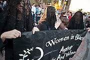 "30 DECEMBER 2008 -- PHOENIX, AZ: Members of ""Women in Black"" in Phoenix, AZ, conduct a vigil in opposition to Israeli attacks on Gaza, Tuesday. About 200 people from a variety of human rights and peace activists organizations in Phoenix, AZ, marched in opposition to the Israeli attacks on Gaza and in favor of Palestinian rights on Tuesday, the fourth day of Israeli air strikes on Hamas facilities in Gaza. Photo by Jack Kurtz / ZUMA Press"