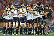 """Brumbies huddle prior to the start of the Super 15 Rugby Union match (Round 7) between the Queensland Reds and the ACT Brumbies played at Suncorp Stadium (Brisbane, Australia) on Good Friday 6th April 2012 ~ Queensland (20) defeated the Brumbies (13) ~ This image is intended for Editorial use only - Required Images Credit """"Steven Hight - Aura Images"""""""