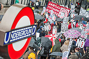 On a day of protest, a march demanding protection for endangered species crosses paths with a Stop the Bombing of Iraq - Don't Attack Syria Demonstration. Westminster, London, UK 4 Oct 2014. Guy Bell, 07771 786236, guy@gbphotos.com