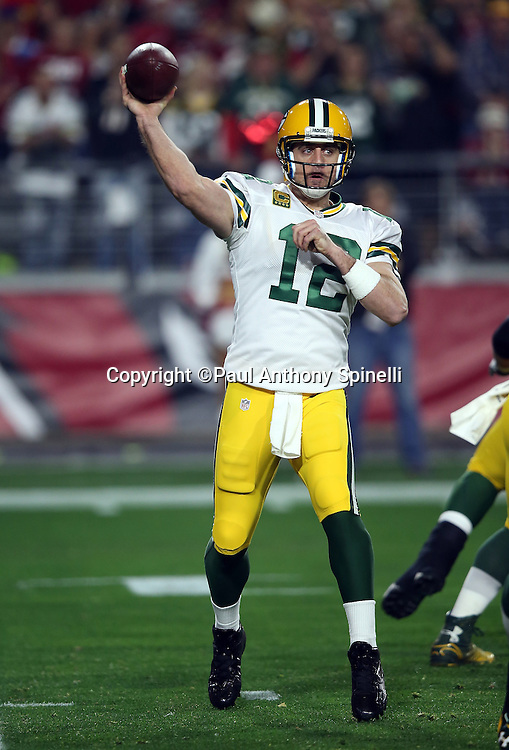 Green Bay Packers quarterback Aaron Rodgers (12) throws a first quarter pass during the NFL NFC Divisional round playoff football game against the Arizona Cardinals on Saturday, Jan. 16, 2016 in Glendale, Ariz. The Cardinals won the game in overtime 26-20. (©Paul Anthony Spinelli)