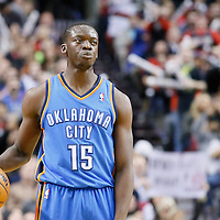 04 December 2013: Oklahoma City Thunder point guard Reggie Jackson (15) brings the ball upcourt during the Portland Trail Blazers 111-104 victory over the Oklahoma City Thunder at the Moda Center, Portland, Oregon, USA.