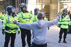 © Licensed to London News Pictures . 13/05/2013 . Manchester , UK . Police clear Market Street in Manchester City Centre as fans confront them . Police confront 100s of Manchester United fans outside the Manchester City store on Market Street after the Manchester United victory parade , this evening (13th May 2013) Photo credit : Joel Goodman/LNP