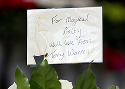© Licensed to London News Pictures. 22/10/2011. Manchester, UK. Flowers left from Coronation Street creator Tony Warren at the funeral of former Coronation Street actress Betty Driver at St Ann's Church in Manchester. The actress lived to the age of 91. Photo credit : Joel Goodman/LNP