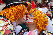 Europe, Germany, North Rhine-Westphalia, Cologne, carnival, bridal pair on November 11, 2011 (11.11.11, each year on this date the carnival starts) leaving the civil registry office in the historical town-hall. ..Europe, Deutschland, Nordrhein-Westfalen, Koeln, Karneval, Hochzeitspaar am 11.11.11 kommen aus dem Standesamt im historischen Rathaus.