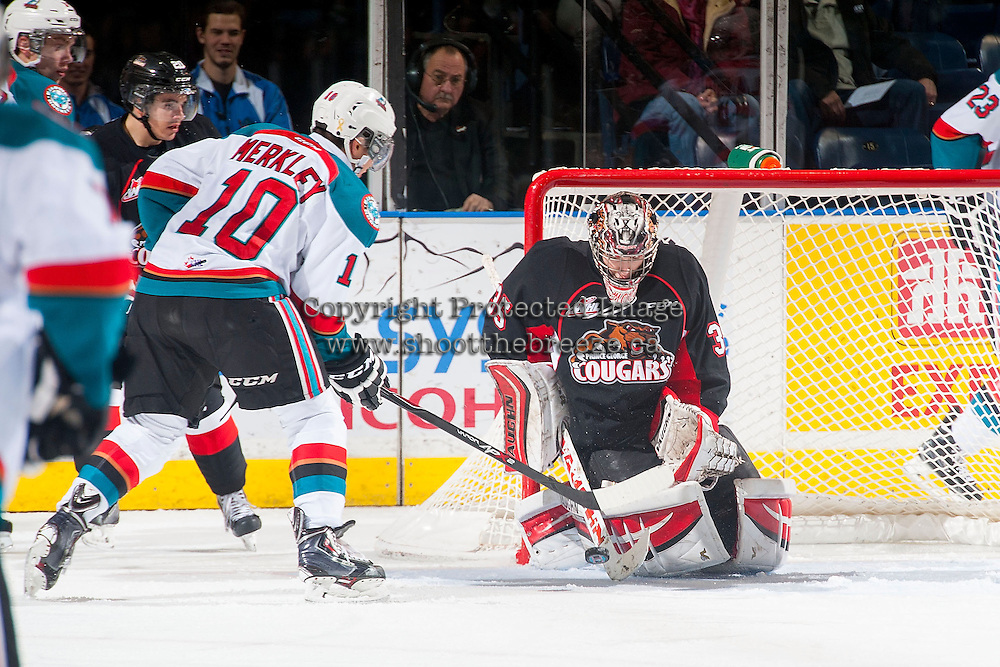 KELOWNA, CANADA - DECEMBER 30: Ty Edmonds #35 of Prince George Cougars makes a save on a shot from Nick Merkley #10 of Kelowna Rockets on December 30, 2014 at Prospera Place in Kelowna, British Columbia, Canada.  (Photo by Marissa Baecker/Shoot the Breeze)  *** Local Caption *** Ty Edmonds; Nick Merkley;
