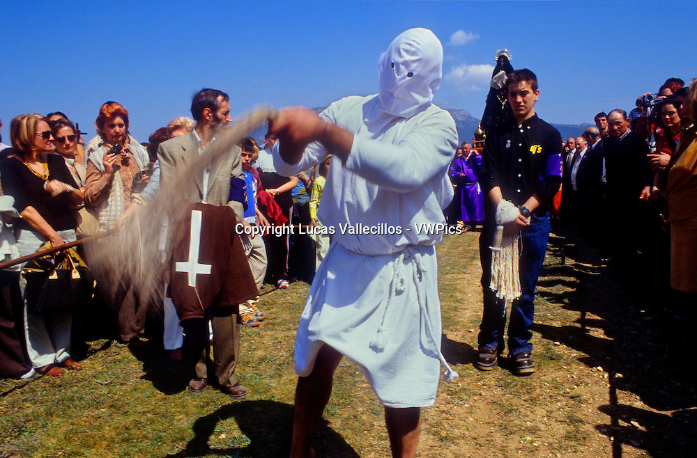 `Picao´ (penitent) flagellating (autodisciplinandose_self-disciplined).´Los Picaos´,Holy Week procession. Cofradia de la Santa Vera Cruz de los disciplinantes. San Vicente de la Sonsierra, La Rioja, Spain