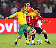 Steven Pienaar and Albert Riera  during the soccer match of the 2009 Confederations Cup between Spain and South Africa played at the Freestate Stadium,Bloemfontein,South Africa on 20 June 2009.  Photo: Gerhard Steenkamp/Superimage Media.