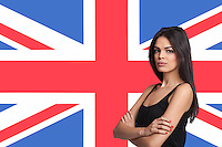 Portrait of young woman against British flag