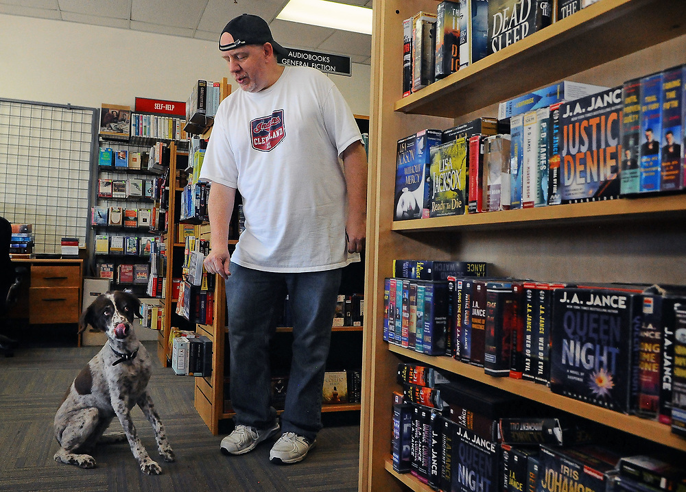jt071117e/ biz/jim thompson/ Nick Bolanos, owner of Archie's Books on Tape and his dog Billie.Tuesday,  July. 11, 2017. (Jim Thompson/Albuquerque Journal)