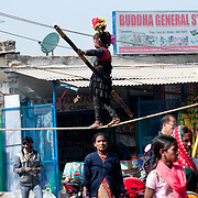 India. Bihar. Bodhgaya. A small girl performs on a tightrope.