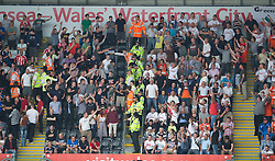 SWANSEA, WALES - Sunday, October 2, 2011: Stoke City supporters goed the Swansea City fans as police and stewards intervene during the Premiership match at the Liberty Stadium. (Pic by David Rawcliffe/Propaganda)
