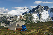 Backcountry camp on Red Face Mountain, Mount Challenger and Whatcom Peak seen in the distance. North Cascades National Park Washington