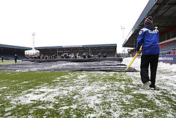 Volunteers & Ground staff remove the snow covers from the pitch prior to kick off - Photo mandatory by-line: Matt McNulty/JMP - Mobile: 07966 386802 - 17.01.2015 - SPORT - Football - Rochdale - Spotland Stadium - Rochdale v Crawley Town - Sky Bet League One