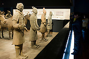 Tourist photographs Terracotta warriors on display in the Shaanxi History Museum, Xian, China