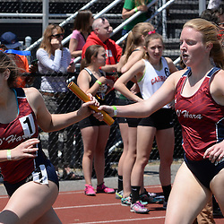 Staff photos by Tom Kelly IV<br /> Cardinal O'Hara's Jessica Hoey (right) hands the baton off to Aine Sheehan in the girls AAA 4x800m relay during the District 12 track and field championships in Philadelphia, Thursday afternoon.