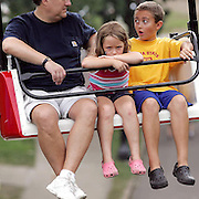 These fairgoers had different levels of interest in riding the Sky Glider Sunday morning at the Iowa State Fair.    DAVID PETERSON/REGISTER PHOTODes Moines, Ia.,
