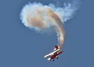 Sean D. Tucker of Team Oracle performs during the Kansas City Air Show in Kansas City, Missouri