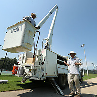 Daniel Johnson and Will Vaughn, employee's with Tupelo, Water & Light, check the lighting at the Tennis Courts at Rob Leake Park on Monday afternoon in Tupelo to ready the courts for an upcoming Tennis tournament this weekend.