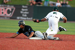 "1 June 2010: Eric Brown trots off after tagging Guillermo Martinez for an out. The Windy City Thunderbolts are the opponents for the first home game in the history of the Normal Cornbelters in the new stadium coined the ""Corn Crib"" built on the campus of Heartland Community College in Normal Illinois."