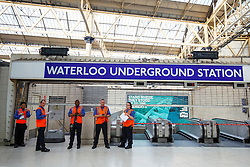 © Licensed to London News Pictures. 09/07/2015. London, UK. Tube staff guarding the entrance of Waterloo Tube station as tube strike shuts down the entire London Underground network on Thursday, July 9, 2015. The strike called by RMT, TSSA and Unite unions is a 27-hour stoppage by about 20,000 Tube staff and shuts down the entire London Underground network. Photo credit: Tolga Akmen/LNP