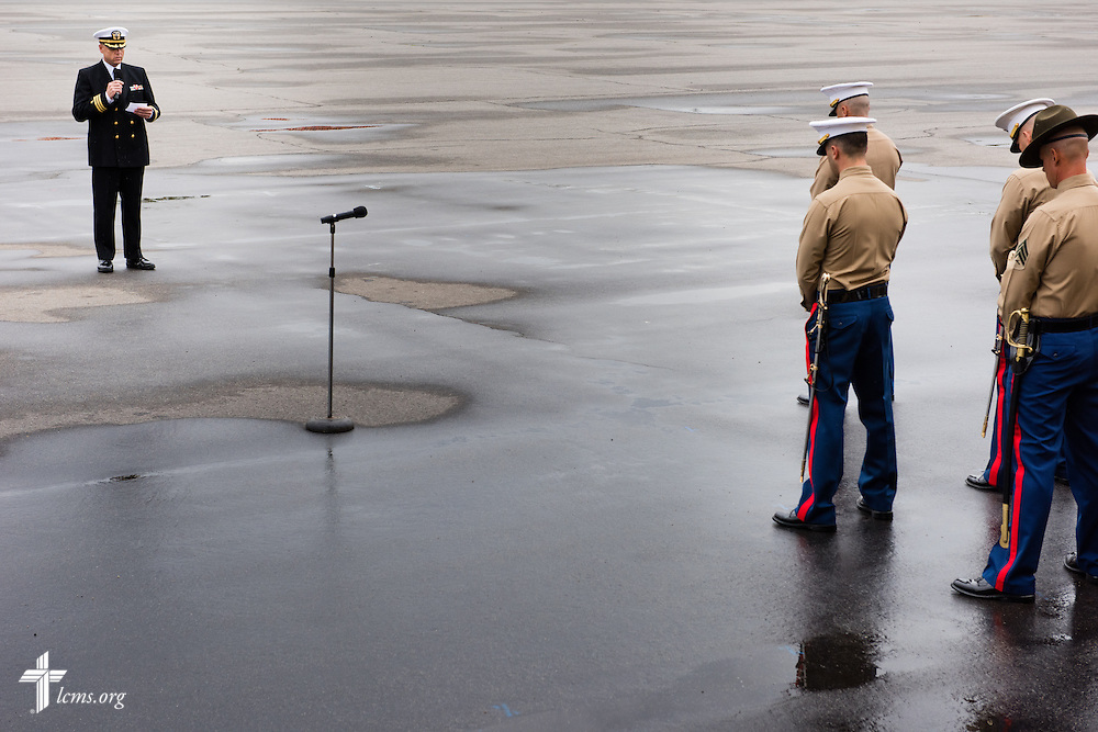 Cmdr. Charles E. Varsogea, chaplain at the Marine Corps Recruit Depot, prays in front of a large crowed Friday, Jan. 30, 2015, in the recruit graduation ceremony at the depot in San Diego, Calif. LCMS Communications/Erik M. Lunsford