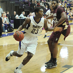 Staff photos by Tom Kelly IV<br /> West Chester's Cory Blake (23) dribbles past Bloomsburg's Armand Leaks (22) during the Bloomsburg at West Chester University men's basketball game Saturday January 18, 2014.