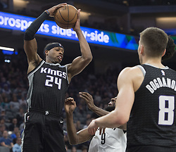 March 1, 2018 - Sacramento, CA, USA - The Sacramento Kings' Buddy Hield (24) picks up a defensive rebound against the Brooklyn Nets in the first half at the Golden 1 Center in Sacramento, Calif., on Thursday, March 1, 2018. (Credit Image: © Hector Amezcua/TNS via ZUMA Wire)