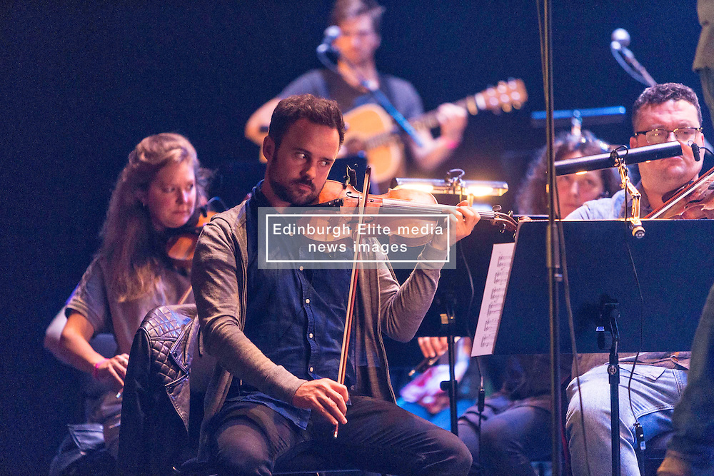 Grit is an orchestra arrangement by Greg Lawson of the seminal album by Martyn Bennett. It is being performed as part of the Edinburgh International Festival.<br /> <br /> It is narrated by David Hayman and features singers including Capercaillie's Karen Matheson
