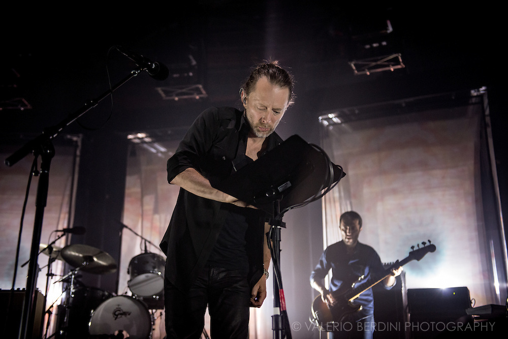 Radiohead playing live at the roundhouse in London on 27 May 2016 touring the latest album A Moon Shaped Pool<br /> <br /> This photo was used by the Guardian on 29 May 2016 https://www.theguardian.com/music/2016/may/29/radiohead-live-review-roundhouse-london-finale-thom-yorke<br /> and the New Statesman on 3 Jun 2016<br /> http://www.newstatesman.com/culture/music-theatre/2016/06/why-radiohead-are-top-game-no-one-else-knows-how-play