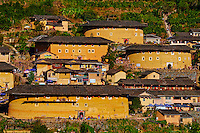 "Chine, Province du Fujian, village de Tian Luokeng, maison forteresse en terre et en bois où logent les membres d'une meme famille de l'ethnie Hakka, inscrit au patrimoine mondial de l'Unesco // China, Fujian province, Tian Luokeng village, Tulou mud house. well known as the Hakka Tulou region, in Fujian. In 2008, UNESCO granted the Tulou ""Apartments"" World Heritage Status, siting the buildings as exceptional examples of a building tradition and function exemplifying a particular type of communal living and defensive organization. The Fujian Tulou is ""the most extraordinary type of Chinese rural dwellings"" of the Hakka minority group and other people in the mountainous areas in southwestern Fujian."