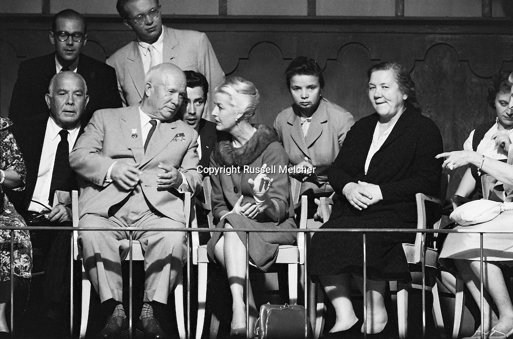 1959. On the set of the making of the musical Can Can, in Hollywood,Khruschev talking to Cabot Lodge's wife next to him, while his wife (in black) seems more interested in watching the stars perform.<br />