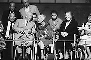 1959. On the set of the making of the musical Can Can, in Hollywood,Khruschev talking to Cabot Lodge's wife next to him, while his wife (in black) seems more interested in watching the stars perform.<br /> While many pictures of Khrushchev and his wife appeared in many publications, not one picture of Mrs Khrushchev appeared in the Russian press.<br /> <br /> <br /> 1959. Sur le plateau de tournage de la com&eacute;die musicale Can Can, &agrave; Hollywood, Nikita Khrouchtchev parle &agrave; la femme de l'ambassadeur Cabot Lodge &agrave; c&ocirc;t&eacute; de lui. Tandis que sa femme (en noir) semble plus int&eacute;ress&eacute; &agrave; regarder les stars hollywoodiennes.<br /> Alors que de nombreuses photos de Khrouchtchev et sa femme ont ete publie dans de les medias de l'Ouest, pas une photo de Mme Khrouchtchev est apparu dans la presse Russe .